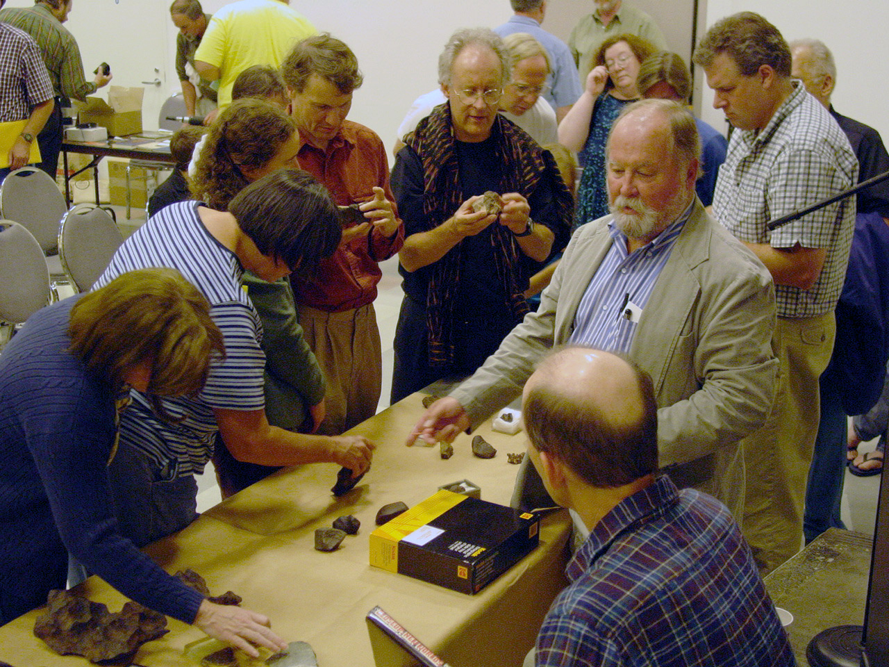 Dick explaining meteorites to crowd at OMSI 2002