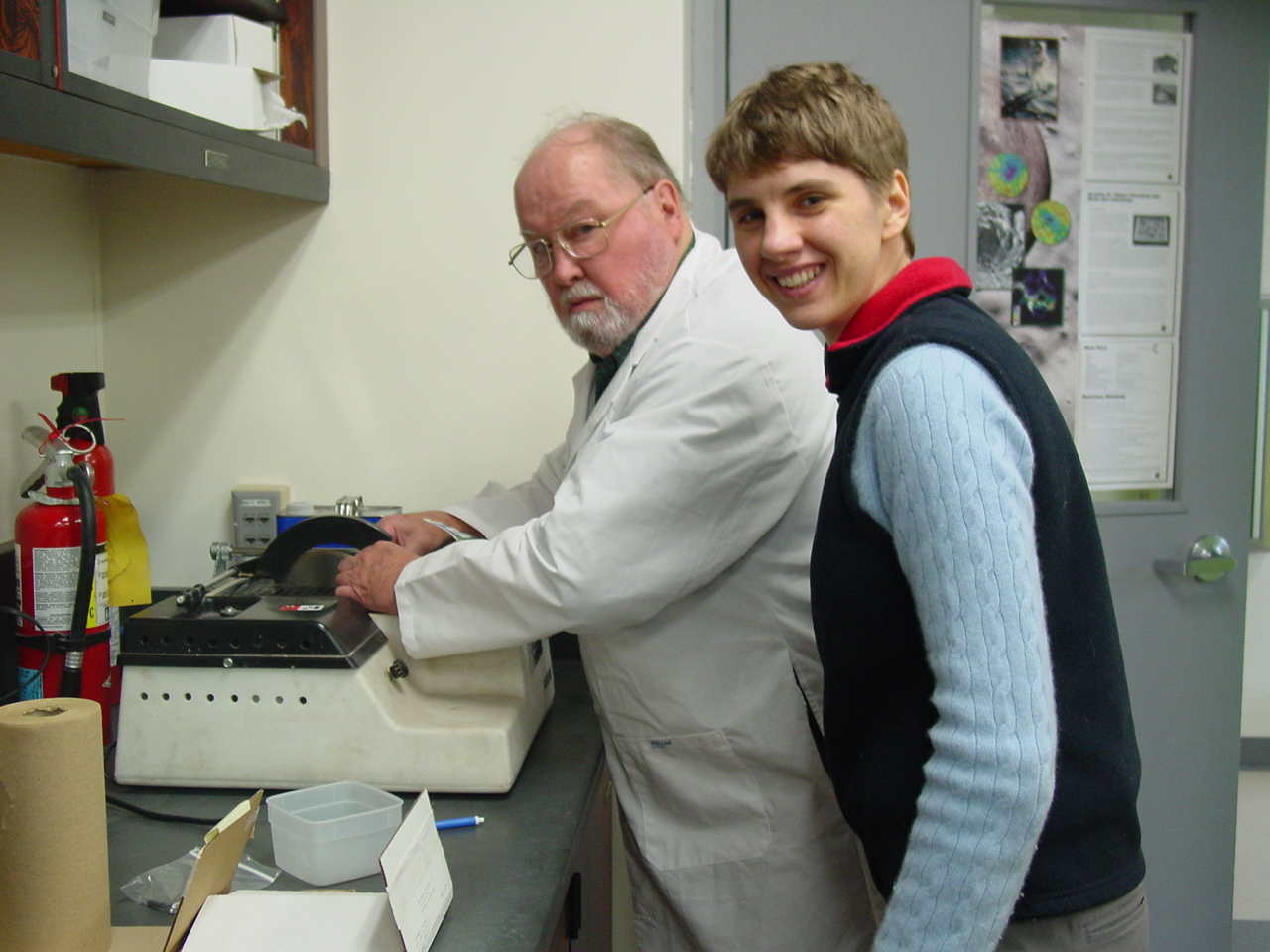 Dick and student Niina cutting samples